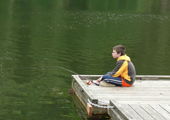 Boy Waiting for Fish