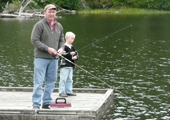 Father and Son Fishing off Dock