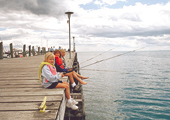 Girls Fishing off Dock