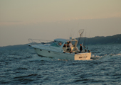 Charter Fishing Boat Heading into Lake Michigan
