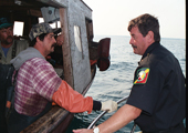 Bay Mills Conservation Officer Inspecting Tribal Fishing Vessel